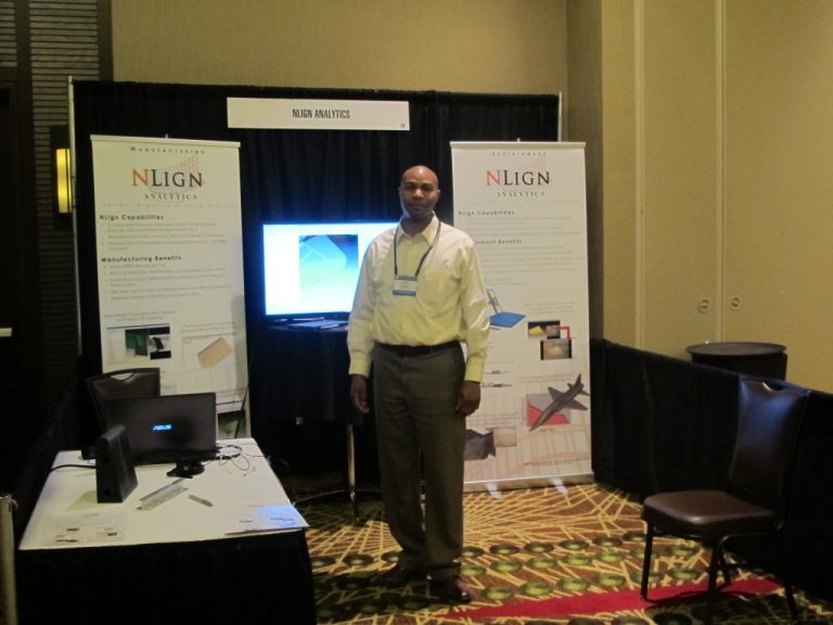 Uriah Liggett in the NLign booth at the 2016 ASIP Conference