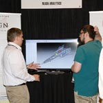 Joe Kesler demonstrating NLign to Attendee at 2016 ASIP Conference