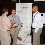 Joe Kesler and Uriah Liggett talking to Attendee at 2016 ASIP Conference