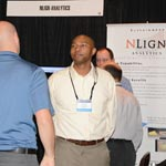 Uriah Liggett talking to Attendee at 2016 ASIP Conference